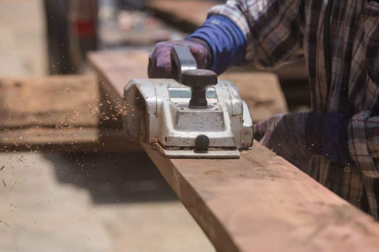 Photo of a factory worker using a large Industrial Electric Planer