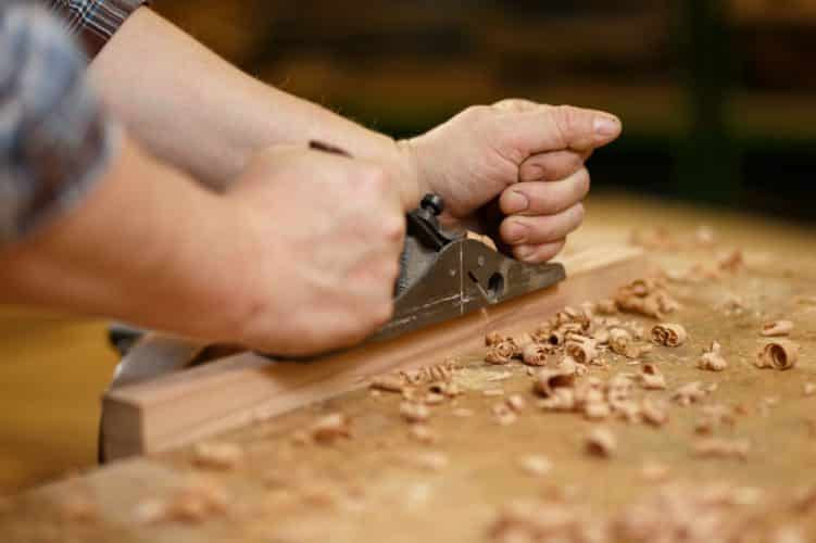 Using a manual hand planer on small piece of wood