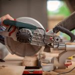 Man cutting wood with a miter saw